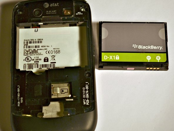 Remove battery cover and battery on the back of the device.