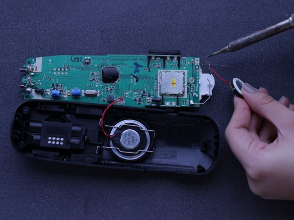 Use a soldering iron to heat up the solder connected to the electric wire.