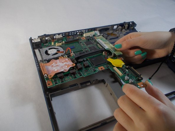 Lift the motherboard off the plastic base.