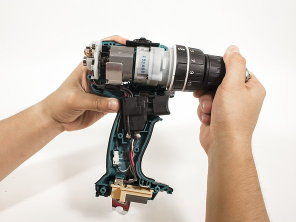 Grip the motor comfortably towards the front of the assembly, and pull it away from the outer casing.
