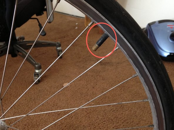 Image 1/2: Gently remove the inner tube starting with the area around the valve.