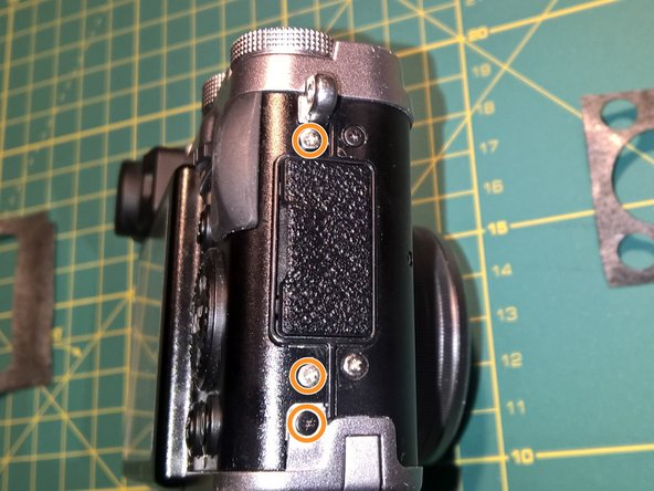 Remove three screws from the right side of the camera