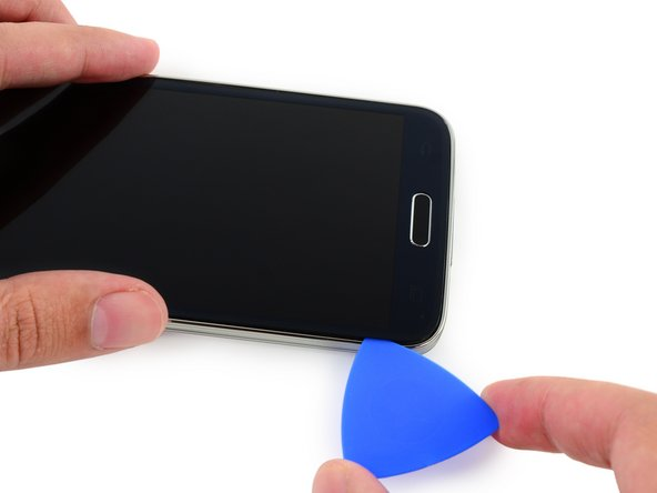 Slide the opening pick all the way to the bottom left corner of the phone, making sure it is securely placed.
