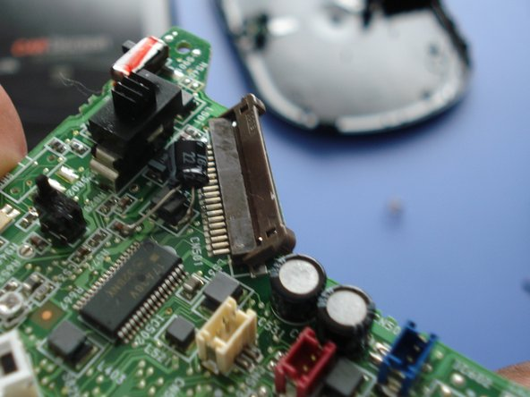 Image 2/3: Unplug the red, white, and blue plugs from the circuit board.