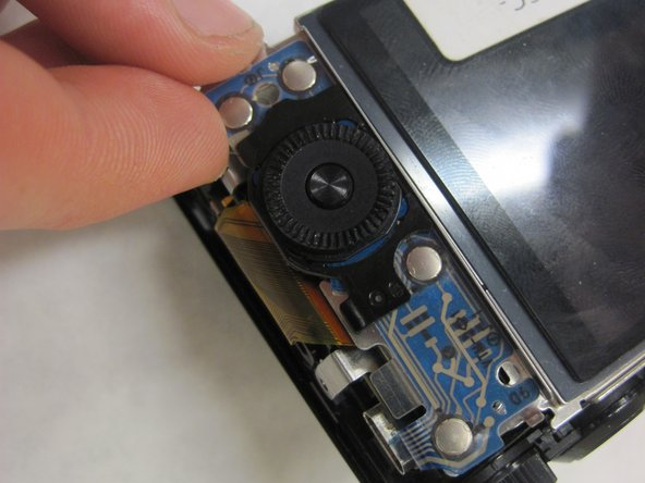 Use your fingers to slide out the controller wheel board.