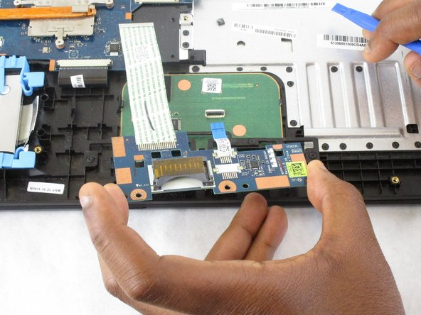 Lift the touchpad module from the laptop.
