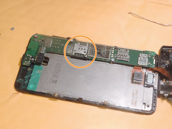 Use the 60/40 lead solder to repair the damaged spot on the sim slot.