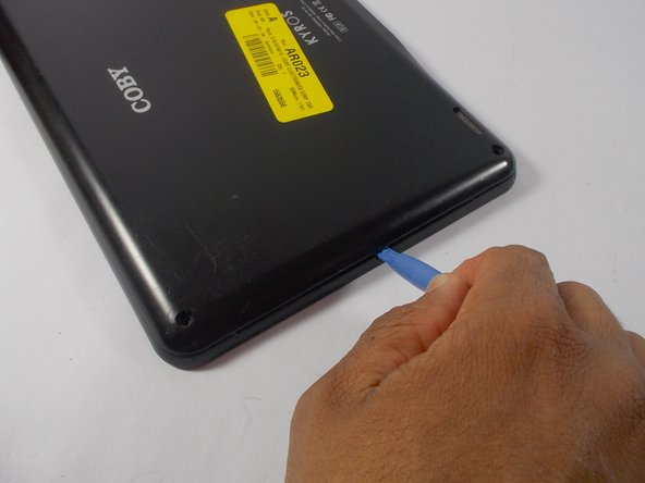 Image 1/3: Use the blue plastic opening tool to wedge the back cover apart from the front.