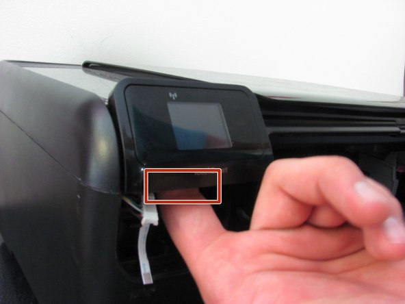 Press the clip directly behind the TouchSmart panel and pull the panel up.