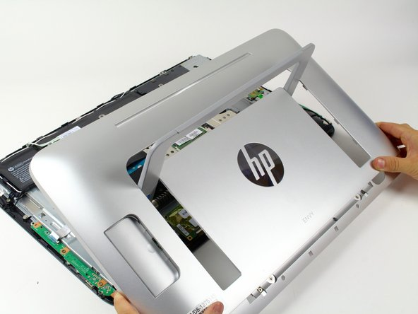 Image 1/1: Carefully lift the cover away from the computer and untangle it from the stand.