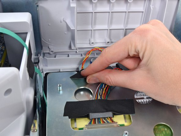Remove the light-bar cable from the LCD bracket and move it out of the way.