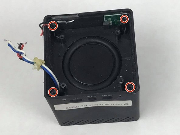 Remove the four 10mm screws from speaker's base.