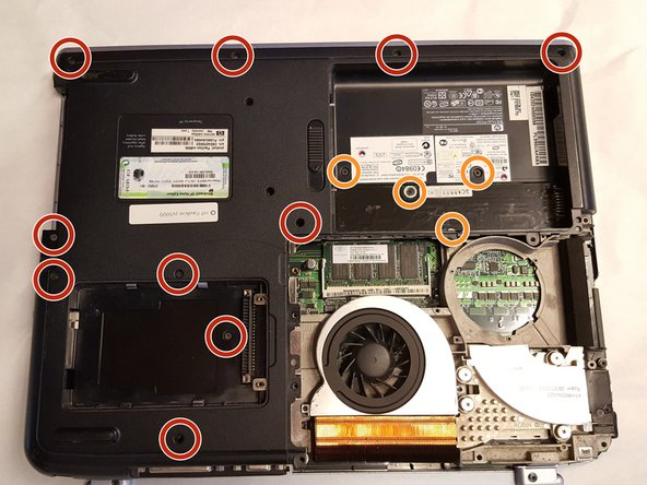 After the CD Drive is removed, return to the back plate of the laptop.