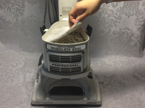 The second filter is thinner and lies at the base of the vacuum. Replace this filter first before placing the larger replacement filter on top of it.
