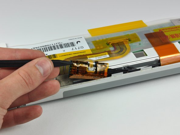 Image 1/1: Use the tip of a spudger to lift the LED driver board out of the clutch cover.