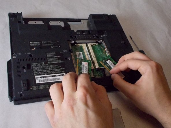 After opening up the compartment, you simply pull out the two RAM units and replace them with the new RAM.