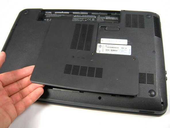 With your hands, lift the panel completely off the base of the laptop.