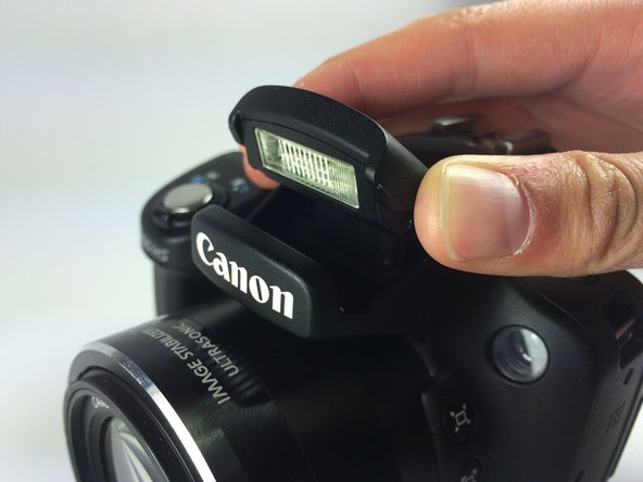 Lift up the flash as you would when using and activating the flash.