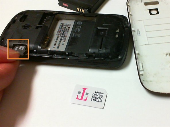 Locate SD card on the lower right. Press in to eject and remove it.