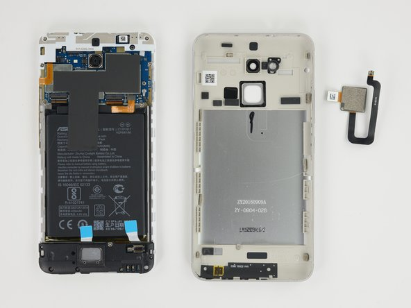 Image 3/3: Fingerprint sensor itself is pretty easy to push out of the rear case. Has a standard press-on connector.