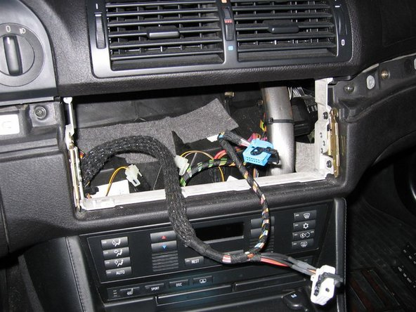 Image 3/3: Remove the old unit completely and connect the widescreen display unit to the car using the exact same 2 plugs
