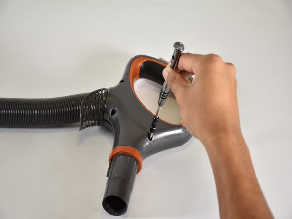Using a T-15 screwdriver, remove the five 15mm screws in the handle by turning them counter-clockwise.