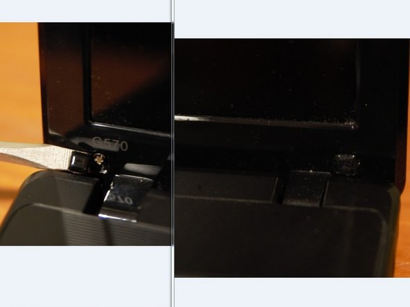 Remove the 2 rubber bumpers which cover the screws. (They are located on the bottom left and right corners of the bezel.)