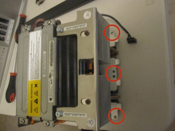 Image 3/3: The screws will loosen but will not come out, they are designed to loosen the unit, but remain in place.