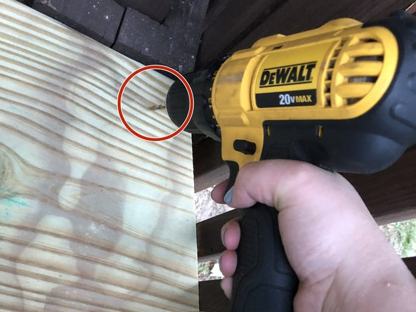 Secure your wood piece (tread) into place using a drill and galvanized screws.