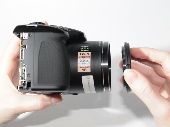 Remove the lens cover to free the zoom motor unit from the camera body.