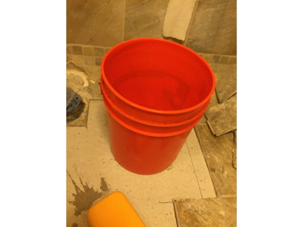Once you have spread the amount of mortar that you will need, use the trowel once more to clean the excess mortar from the floor. Excess mortar can be returned to the bucket.