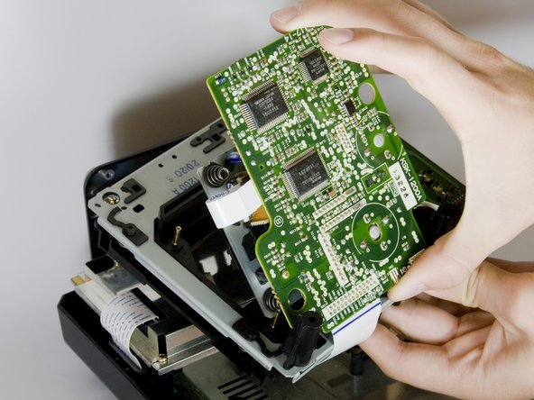 Image 3/3: Carefully remove the CD tray from circuit board.