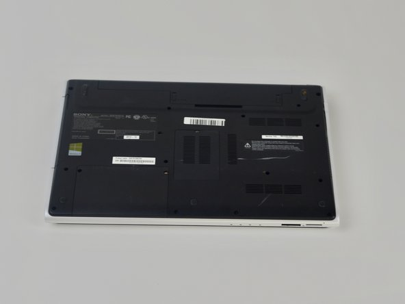Flip laptop over so the bottom is facing upwards.