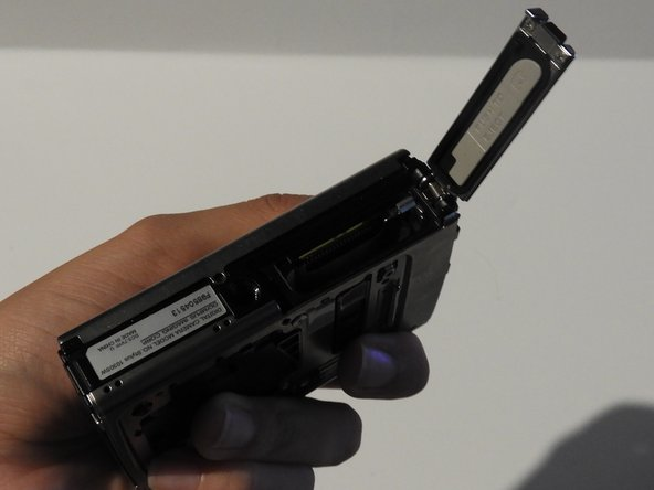 Open the battery compartment cover.