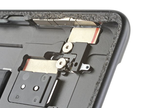 The SSD cover sits on one side of a tiny see-saw, waiting for a friendly SIM eject tool or paperclip to come along and sit on the other side. When that happens, the see-saw pushes the SSD cover away from the case, and bam! Just like that you can upgrade your storage.