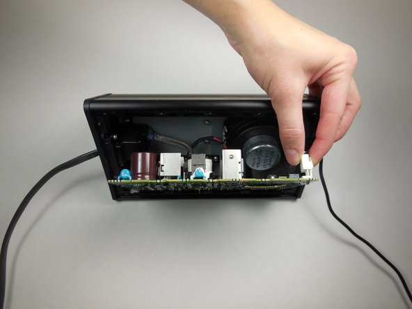 Image 2/2: After disconnecting the first wire, the two attached wires can be more easily accessed.