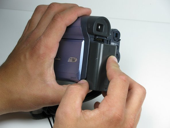 Then, pull the battery down away from the camcorder. Pull out as it becomes free.