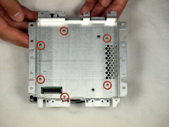 Flip the optical drive assembly upside down
