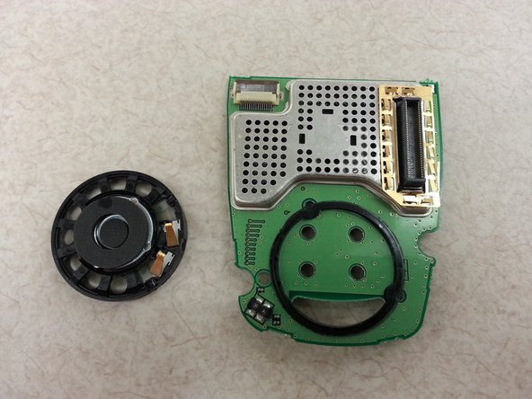 The speaker is lightly glued to the circuit board.  When prying the speaker off, there will be some resistance.