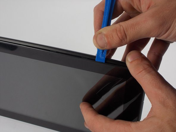 After inserting the plastic opening tool, run it around the device a few times to loosen the external cover.