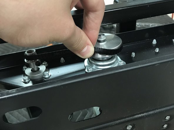 First You need to remove the belt from the motor. To do this simply use your fingers and pinch the belt and at the same time spin it and it should pop right off.