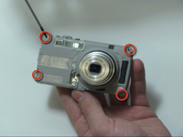 Image 1/3: Circuit ribbon is attached at the top left of the camera. Be careful when separating the front and back of the camera.