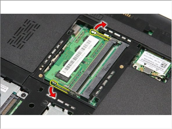 Push apart the memory retention clips to release the memory module.