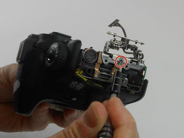 Remove one 2.8 mm Phillips #PH00 black screw on the side of the swivel assembly by using the PH00 screwdriver.