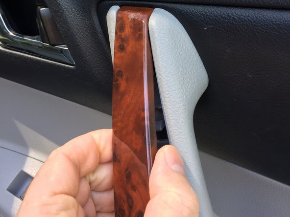 If you prefer to use a plastic or metal spudger or another type of plastic auto trim removal tool you could carefully slip that tool in the crevice and pop the trim.