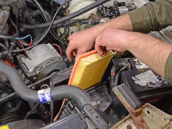 Grab the air filter and remove it from the filter housing.