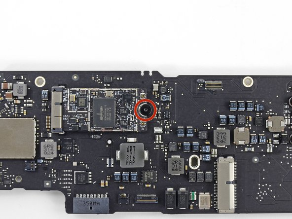 Remove the single 2.9 mm T5 Torx screw securing the AirPort/Bluetooth board to the logic board.