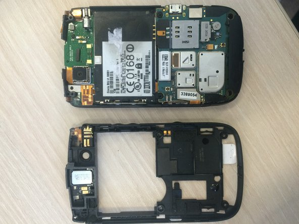 Remove the back panel using the plastic opening tool.