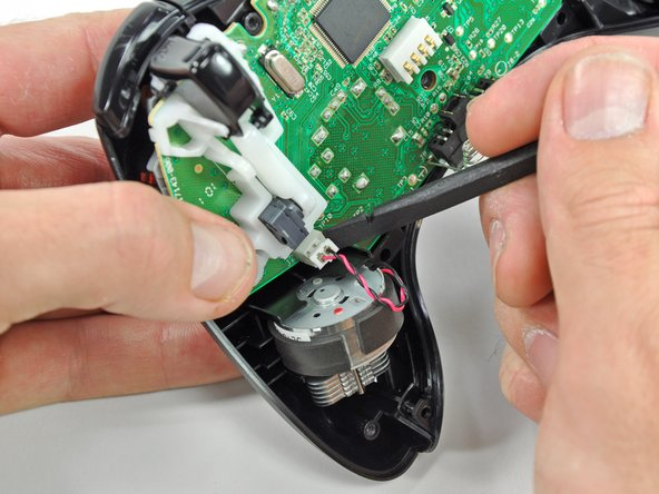Remove the vibration motor from the other side of the controller using the same method previously described.