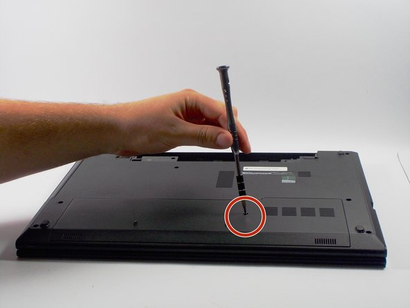 Image 1/3: Using a PH0 sized screw driver, carefully remove the 4mm  screw from the bottom cover.